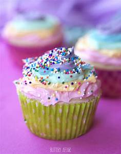 Vanilla Cupcakes with Rainbow Frosting and Strawberry Filling