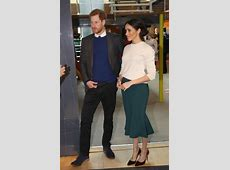 Prince Harry and Meghan Markle hold hands at the saloon in