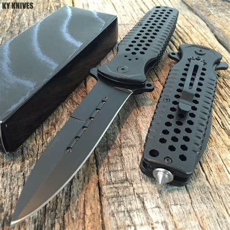 large black spring assisted open stiletto bowie tactical