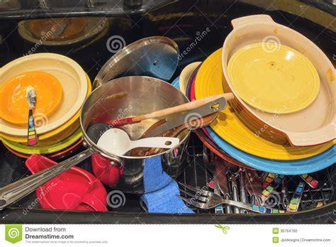 kitchen sink  dirty dishes utensils  pot stock