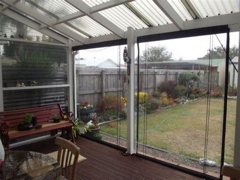 semi enclosed deck  pvc blinds  house