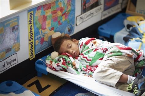 sleep well 10 ways we help get a great daycare nap 313 | older boy sleeping on cot at daycare