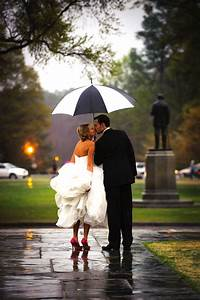 Eight adorable umbrellas to ward off wedding day rain for Umbrella wedding photos