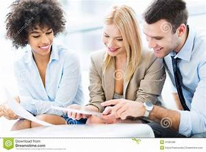 Young Business People Discussing In Office Stock Photo ...