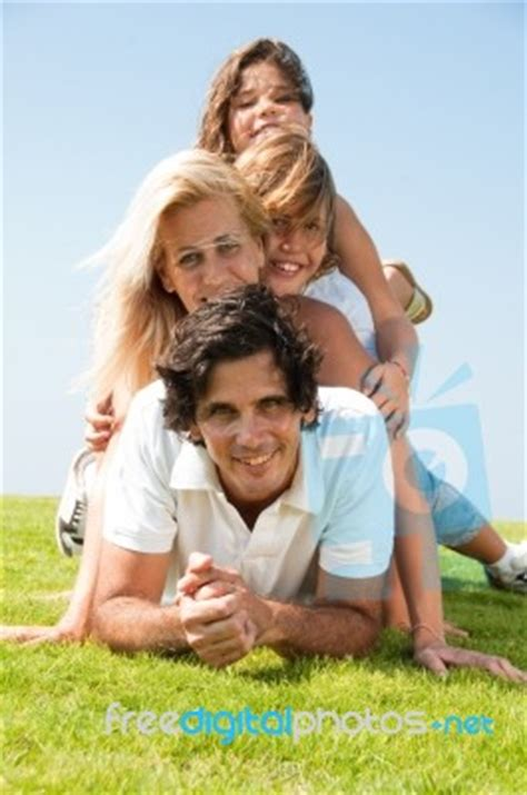 Happy Family In Garden Stock Photo  Royalty Free Image Id