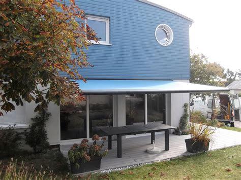 pose d une terrasse et store banne par renov habitat