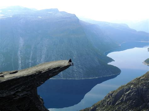 My Friend On The Edge Of A Cliff Trolltunga Norway
