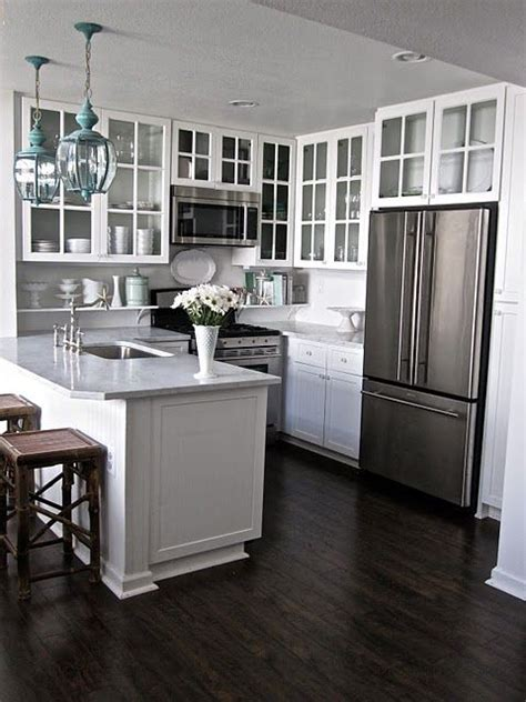 kitchen white cabinets dark hardwood floors whitegray