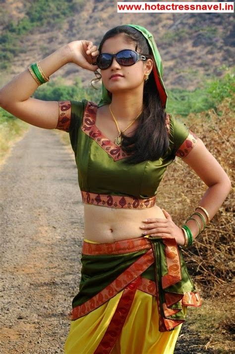 indian madhulika navel cleavage pics in sari saree click to see more