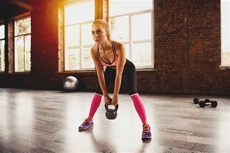 kettlebell workout arm minute working blonde face exercise businessman gym arms workouts difficulties site challenge