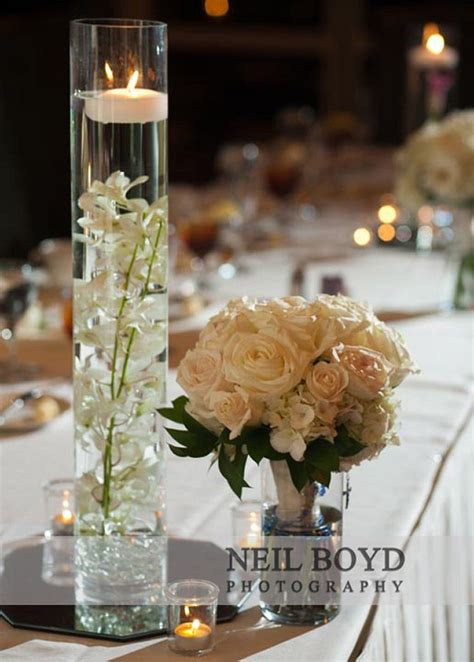 white flowers  water  floating candle vases