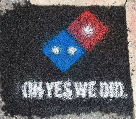 Dominos is filling potholes with ads to protect pizzas ...
