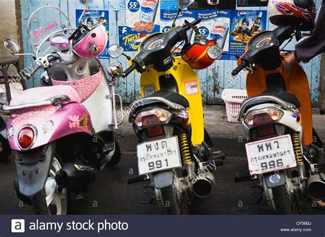 Brightly Coloured Motorcycle Scooters And Helmets Thailand