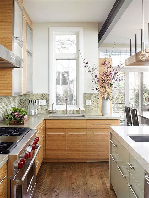 A tall, narrow window above the kitchen sink offers views