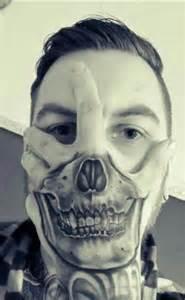 Skull Face Hand Tattoo