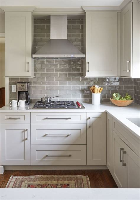 white cupboards  neutral subway tile backsplash