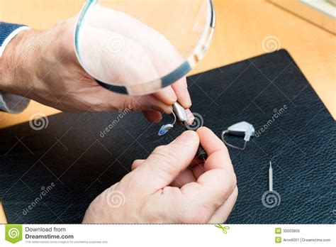 Acoustician Working On A Hearing Aid Royalty Free Stock