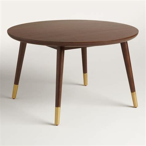 coffee table features splayed legs  gold