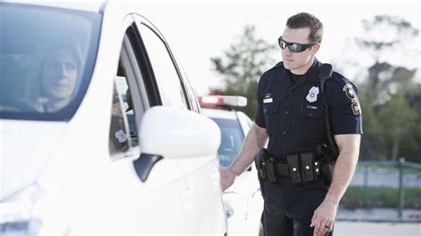 why do cops tap tail light the reason police officers tap your taillight when they