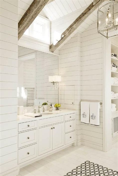 white master bathroom features  shiplap vaulted ceiling dotted  rustic wood beams accented