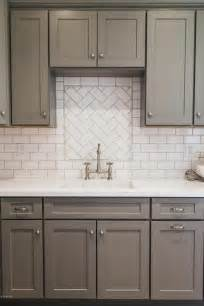 kitchen backsplash with white cabinets gray shaker kitchen cabinets with white subway tile herringbone sink backsplash transitional