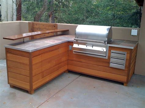 An Outdoor Barbeque Island That Looks Like Wooden