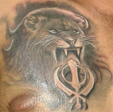 grey ink lion  khanda tattoo