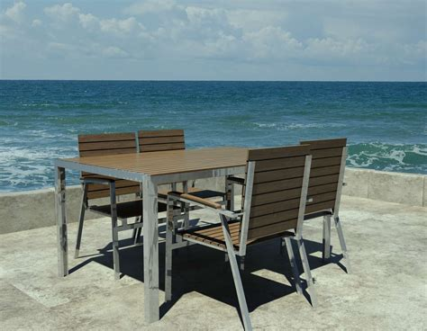 chaises exterieur designer garden table in teak and stainless steel with