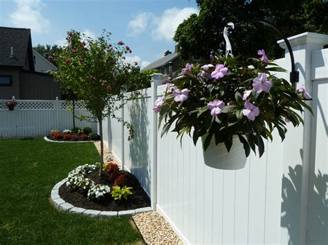 landscaping around fence wood vinyl aluminum fence installation in melrose ma done right landscape and construction