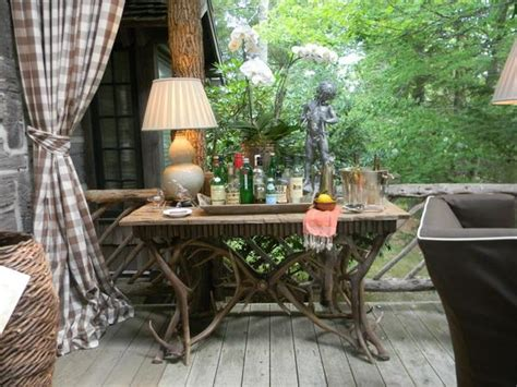beautiful table decoration and rustic themed decor turning porch into stylish retreat