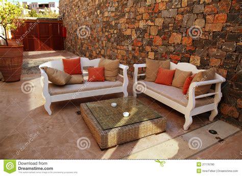 mediterranean patio with white outdoor furniture stock