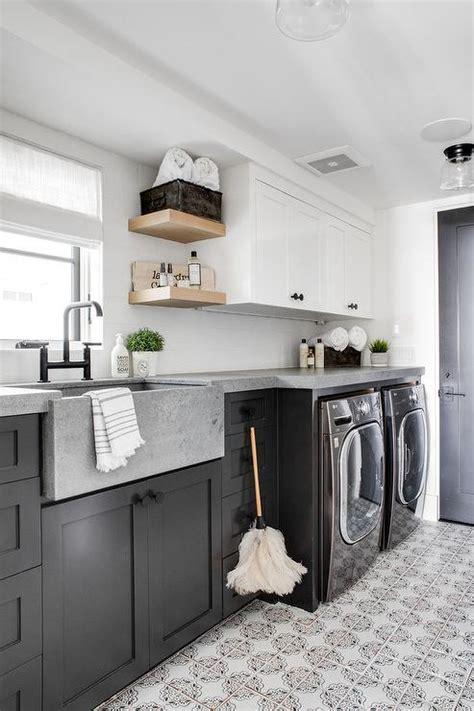 black shaker laundry room cabinets  concrete apron