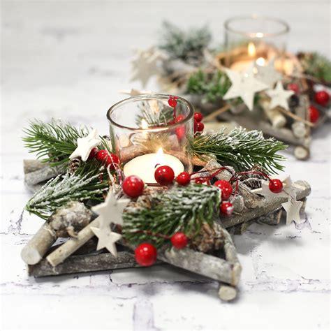 kleine gestecke weihnachten adventsgesteck in sternform mit glasteelichthalter weihnachtsgeschenke weihnachten