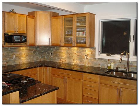 what color countertops go with oak cabinets black granite countertops with oak cabinets