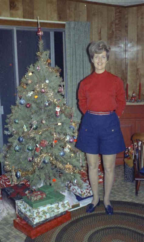 mid century women enjoying real christmas trees