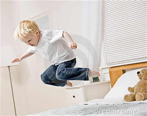 boy jumping  mid air  bed  bedroom stock images