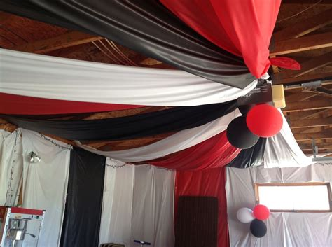 Graduation parties are way to celebrate 12+ years of hard work and dedication! Half the garage ceiling and plastic tablecovering on walls, too   Graduation party decor ...