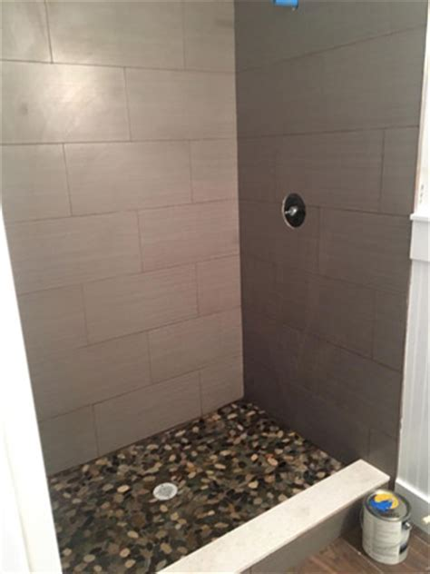 Wood Look Tiles and River Rock Installation in Atlantic Beach