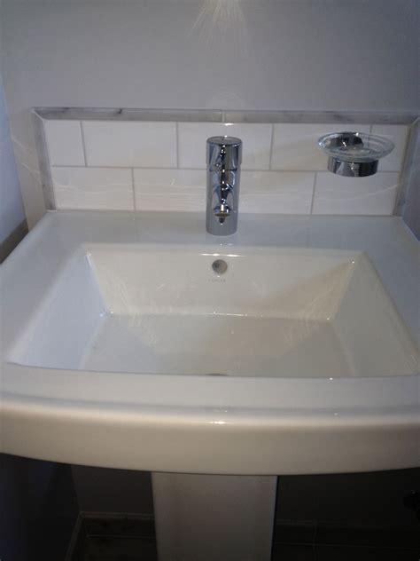bathroom sink backsplash ideas pedestal sink with custom back splash subway tile with