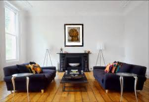 modern living room with crown moldings dueling blue sofas wide plank wood floor and a - Black Livingroom Furniture