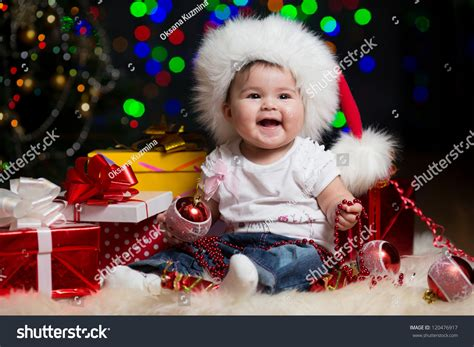 Santa Claus With Maiden In Bright Clothes Stock Baby Santa Claus Hat Gifts Stock Photo 120476917