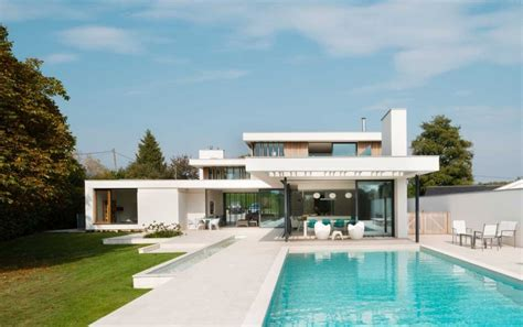 modern home features white volumes and water features defining the river house near oxford england freshome com