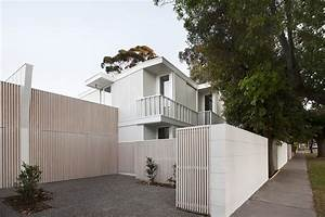 Folded Facades Give Two Identical Homes Their Own Identity