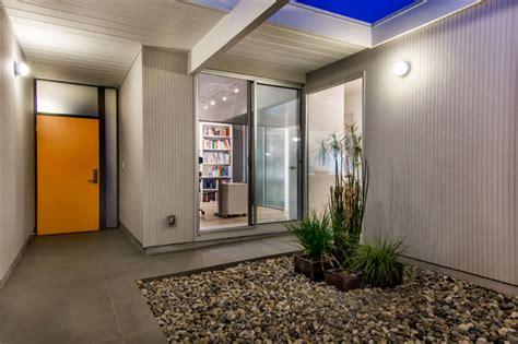 eichler atrium orange front door midcentury exterior