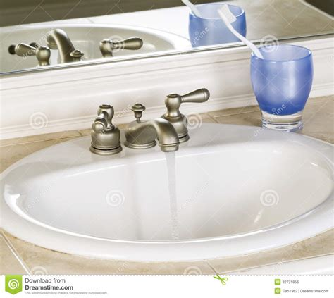 Kitchen Sink Stinks When Running Water by White Bathroom Sink And Faucet In Open Position With Clean