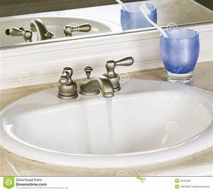 white bathroom sink and faucet in open position with clean With is bathroom tap water drinking water