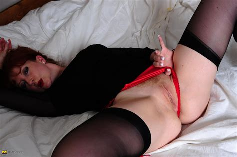 hot red milf playing with her wet pussy