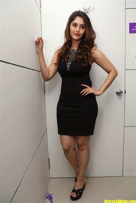 surabhi hot legs show stills  black dress actress album