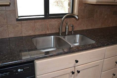 lazy granite brown countertop traditional kitchen
