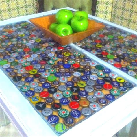 beer cap table epoxy bottle top table with poured epoxy set in an old window